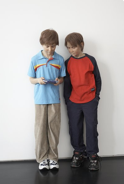 Patricia Piccinini, Game Boys Advanced, 2002-2003, Silicone, acrylic, human hair, clothing, hand-held video games, edition of 3, 140 cm × 36 cm × 75 cm