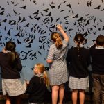 Launch of Melbourne Now exhibition, the biggest in NGV history. Children add bird stickers to Juan Ford's work. Picture Kylie Else