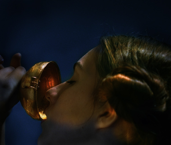 In one image, the model drinks from an ancient gold cup. Photo: Bill Henson