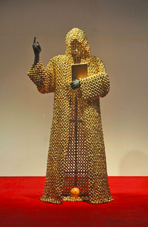 A Titarubi figure in a cloak of golden nutmegs