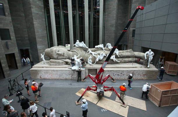 Xu Zhen's 'Eternity-Buddha in Nirvana' gets installed at the National Gallery of Victoria