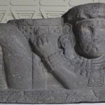 Sacrificial stone with face of Tlaloc god of rain and lightning.