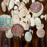 Lin Tianmiao, Badges, 2009, White silk satin, coloured silk threads, gold embroidery frames made of stainless steel, Dimensions variable Collection: Gene & Brian Sherman, Sydney. Installation view, AGNSW 2015. Photo: Jenni Carter, AGNSW